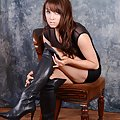 Leather boot lover Laura strips down to her sexy black lingerie