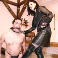 Mistress Helena lashing her boot lickers