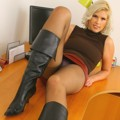 Saucy secretary in red leather miniskirt