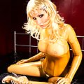 Susan Wayland in yellow latex catsuit & transparent boots