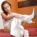 Sweet Trixie in white lingerie and overnee boots