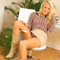 Blonde in sexy secretary outfit in the office