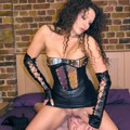 Leather domina is teasing her slave