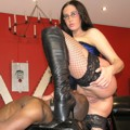 Sublime Mistress in corset & boots forces guy to lick her holes