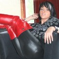 Beautiful Anja teasing in red and white boots