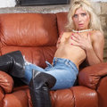 Nicole is wearing some tight blue jeans and some big leather boots