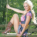 Blonde in western boots on swing