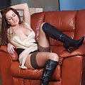 Busty brunette Candi reveals her gorgeous leather boots