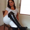 Madame sits down at the table in her stunning rain boots
