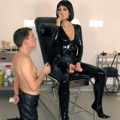 A slave serves Lady in black latex catsuit