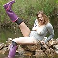Cute babe splashes out in violet wellies