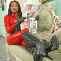Goddess Sonya in red latex drilling a human dog