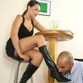 A slave licks her Mistress boots and feet