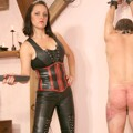 Mistress Taurea whipping her slave with riding crop
